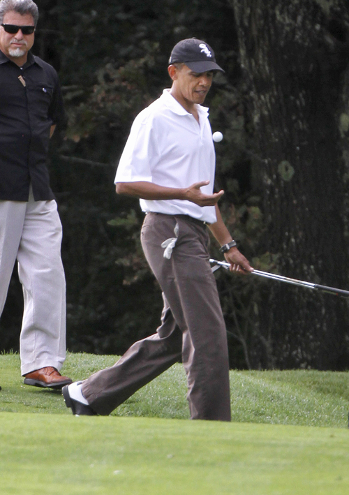 In this Aug. 25, 2010, photo, President Barack Obama plays golf at the Mink Meadows Golf Club, in Vineyard Haven, Mass., on the island of Martha's Vineyard. President Barack Obama will again vacation with his family in Martha's Vineyard at the end of this month.