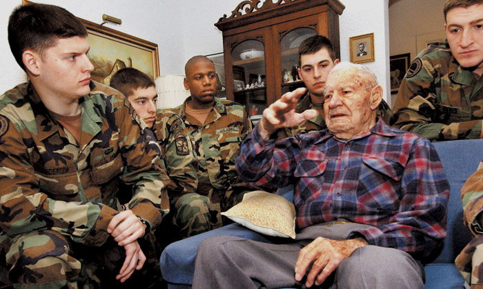In this 2005 photo, Albert Brown speaks with members of the Army ROTC at his daughter's home in Pinckneyville, Ill.