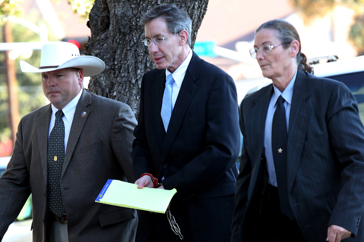 Warren Jeffs is taken into the Tom Green County Courthouse in San Angelo, Texas, on Monday. Jeffs was sentenced today to life in prison for sexually assaulting two girls, ages 12 and 15, whom he'd taken as brides. Jeffs has led the Fundamentalist Church of Jesus Christ of Latter Day Saints since 2002.