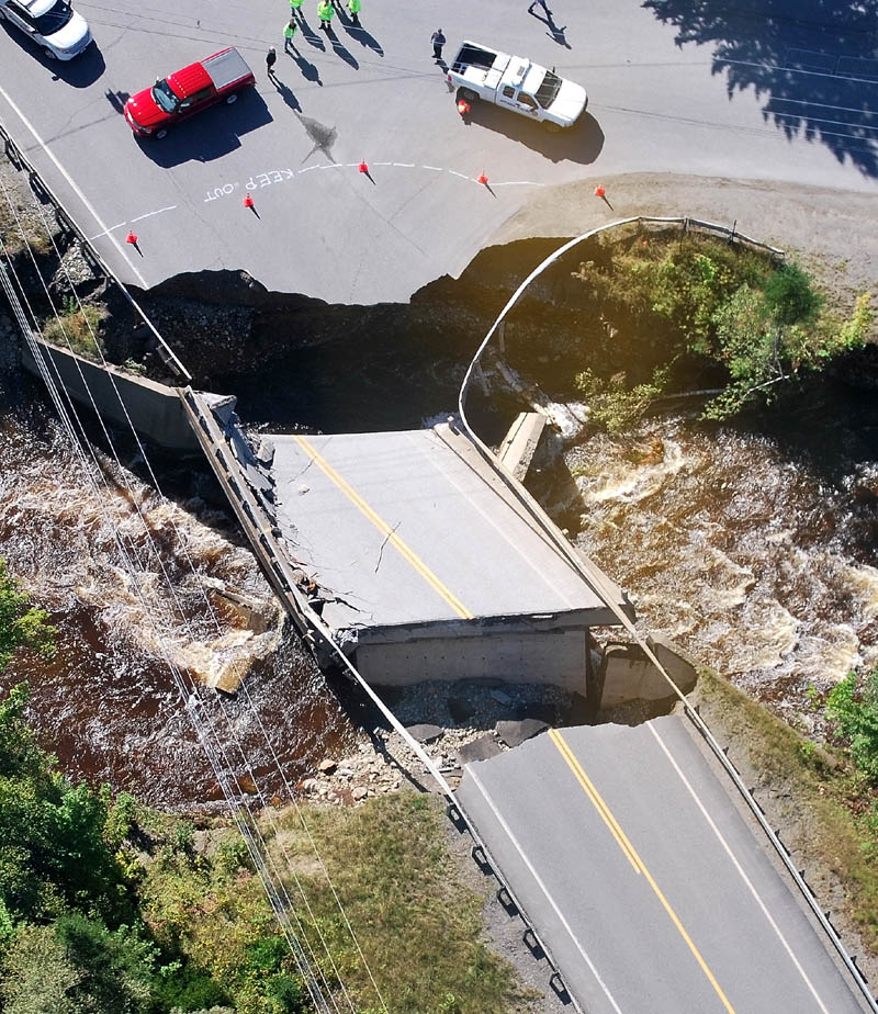 Maine officials, including Gov. Paul Lepage, surveyed damage Monday from Tropical Storm Irene, including two washed out bridges on Route 27 in Carrabassett Valley. The damage cut off Sugarloaf Mountain, though Maine Department of Transportation has since established detours. According to the department, the detour for Route 27 is: from Kingfield, Route 142 to Phillips, then Route 4 from Phillips to Rangeley, then Route 16 from Rangeley to Stratton.