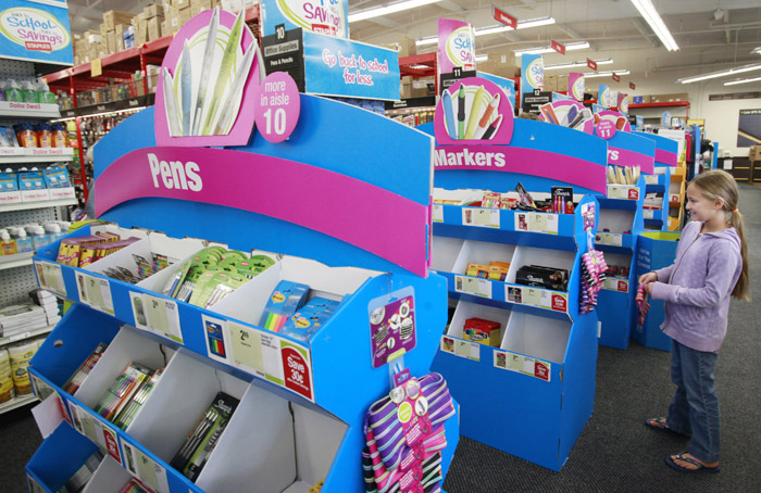 A fifth-grade student shops for school items at Staples in Menlo Park, Calif. Prices on everything from socks to notebooks are rising 10 percent on average this fall, just in time for back-to-school shopping.(AP Photo/Paul Sakuma, file)
