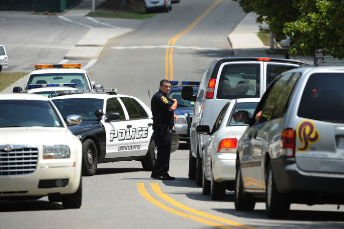Police stop traffic at Virginia Tech after a gunman was reported on campus today.