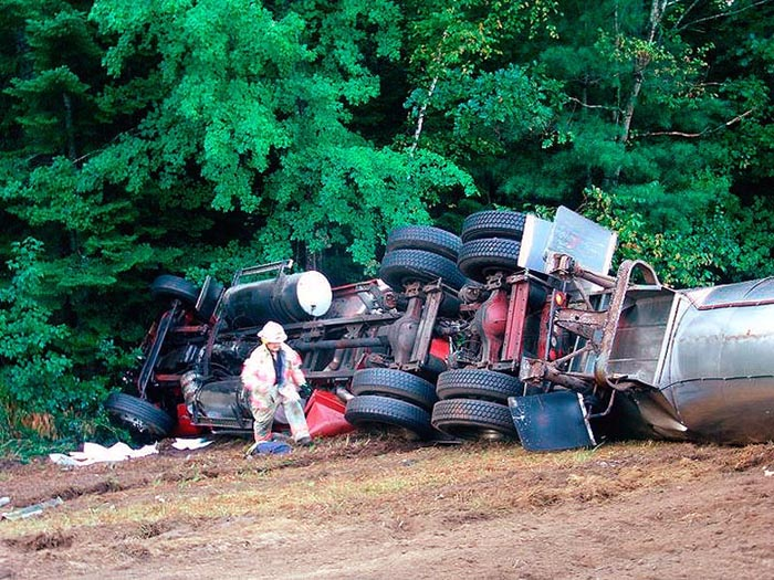 A tractor-trailer lies on its side in Lebanon this morning after its driver veered to avoid hitting a car on Carl Broggi Highway. Both drivers were transported to Goodall Hospital in Sanford with non-life threatening injuries.