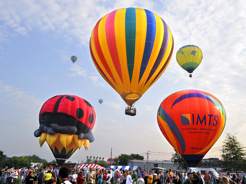 Hot air balloons are launched from Railroad Park in Lewiston at sunrise today.