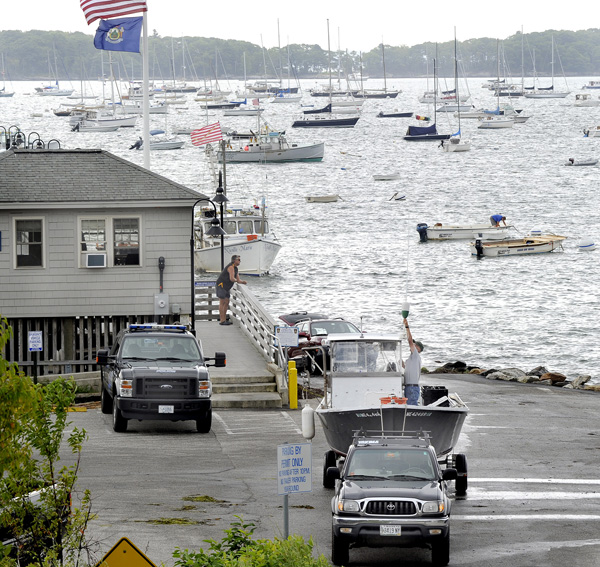 Boat owners start hauling their boats to safety today at the Falmouth Town Landing where hundreds of boats are moored and in danger of damage from Hurricane Irene, whose effects could be felt in Maine as early as Sunday.
