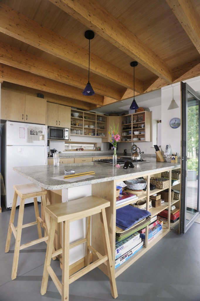 Stools fit under the kitchen island.