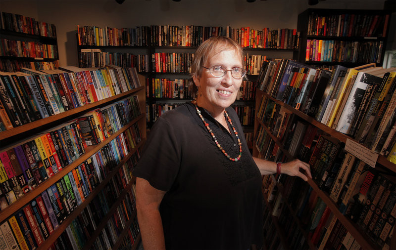 """Paula Keeney and her partner opened Mainely Murders Bookstore in their Kennebunk barn-turned-garage-turned-store a few months ago. Their books, all mysteries, range from """"cozies"""" like Christie's Miss Marple series to dark Scandinavian novels."""