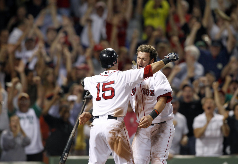 Jarrod Saltalamacchia, right, celebrates with Dustin Pedroia after Saltalamacchia scored in the bottom of the ninth to give Boston a 3-2 win.