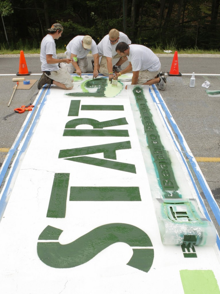The starting line for the Beach to Beacon in Cape Elizabeth will be easy to spot Saturday thanks to the paint work done Thursday by, left to right, Ryan McGillivray, Matt Tobin, Eli Madsen and Mike DiDonato.