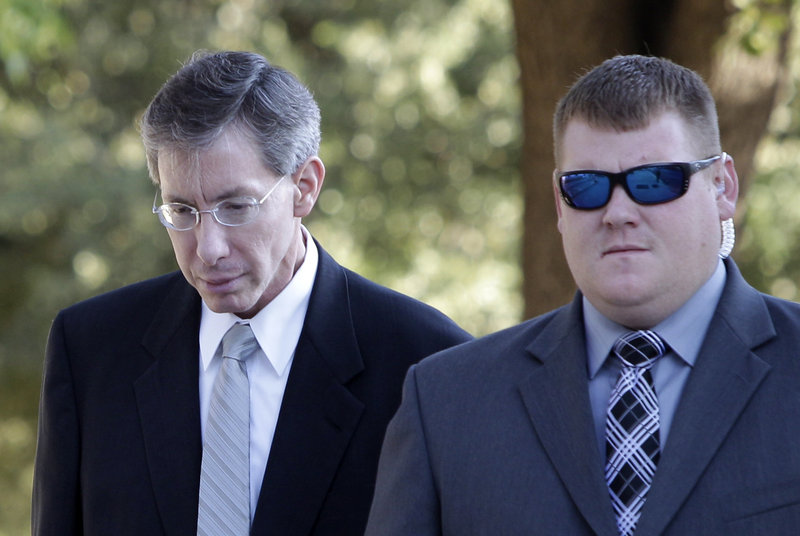 Sect leader Warren Jeffs, left, arrives at the Tom Green County Courthouse in San Angelo, Texas.