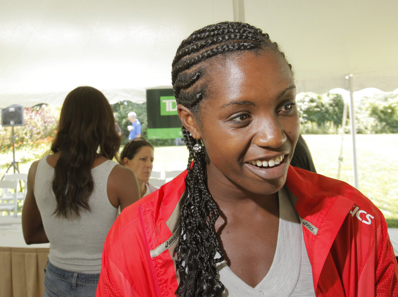 Diane Nukuri Johnson attended the University of Iowa after representing Burundi in the 2000 Sydney Olympics.