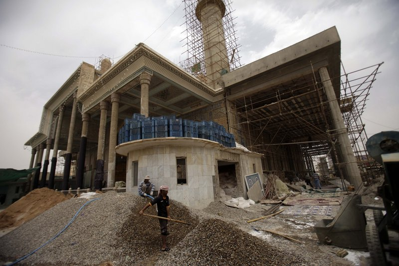 Construction workers have nearly finished rebuilding the al-Askari shrine in Samarra, 60 miles north of Baghdad, Iraq. The day the shrine was bombed – Feb. 22, 2006 – began one of the darker chapters in Iraq, sparking intense violence between Shiite and Sunni Muslims.