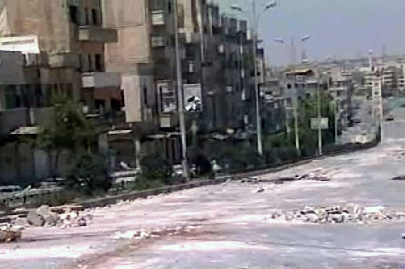 This image taken from television shows empty streets strewn with debris Thursday in the city of Hama, the Syrian center of many anti-Assad protests.