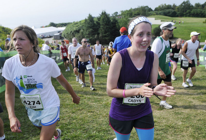 Eighteen-year-old Cadyn Wilson, right, of Hallowell walks from the finish line after her first Beach to Beacon race. Wilson hadn't seen the course before running and was shocked when the final hill appeared.