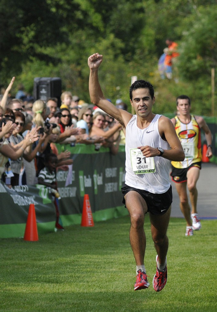 Louie Luchini of Ellsworth pumps his fist as he crosses the finish line at the Beach to Beacon 10K, winning the Maine men's division with a time of 30:35.