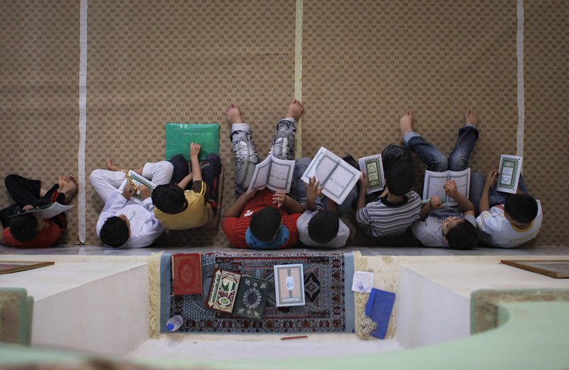 Libyan children study the Quran inside a mosque during the Muslim holy month of Ramadan in the rebel-held town of Benghazi, Libya, on Saturday. Rebels opened a new front Saturday and hope to fight their way to the capital, Tripoli.