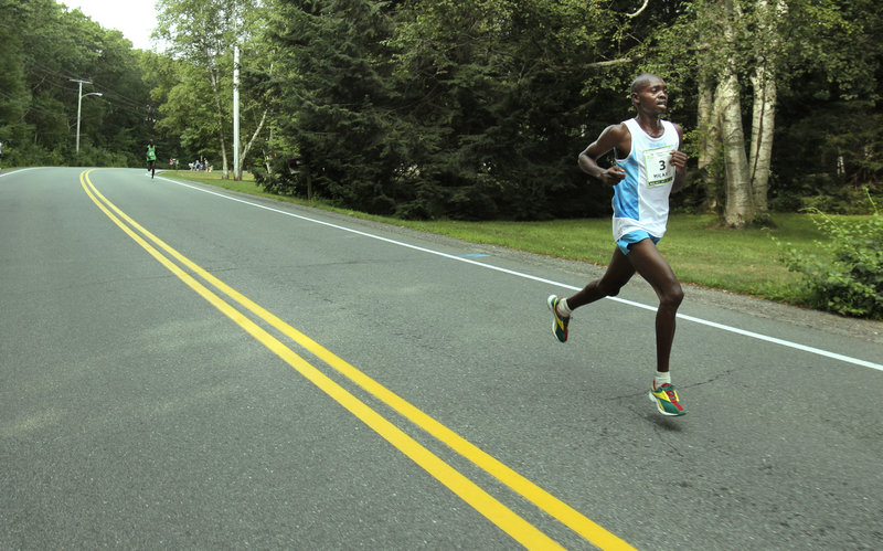 Gregory Rec/Staff Photographer Micah Kogo was on his own by Mile 4 of the Beach to Beacon 10K, having opened up a comfortable lead on fellow Kenyan Lucas Rotich. Kogo finished in 27 minutes, 46.9 seconds, becoming the 11th Kenyan champion in the race's 14-year history.
