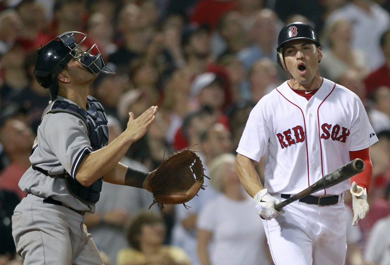 Yankees catcher Russell Martin watches a popup by Boston's Jacoby Ellsbury with the bases loaded in the sixth inning Sunday night at Fenway Park. The Red Sox tied the game in the bottom of the ninth and won it on Josh Reddick's RBI single in the 10th.