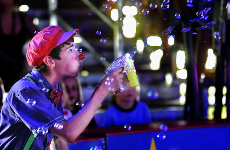 Sam Gurwitt of Norwich, Vt., blows bubbles during the Circus Smirkus show Monday at Rockin' Horse Stables in Kennebunkport. The traveling circus, founded in 1987, gives children hands-on experience in the circus arts. The show continues today in Kennebunkport, then moves to Freeport on Thursday.