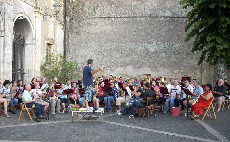 Members of the Portland-based Italian Heritage Center Band and La Banda Musicale Enrico Gai practice together in a square in Nepi, Italy, last year, conducted by Gianni Guiseppe Bannetta, director of the Nepi band.