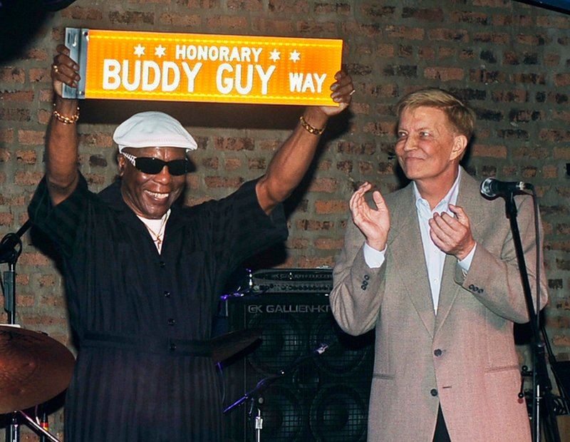 Chicago Alderman Robert Fioretti, right, applauds after reading a proclamation from Mayor Rahm Emanuel in honor of Chicago blues legend Buddy Guy, left, who was presented with a street name in his honor in Chicago on Sunday.