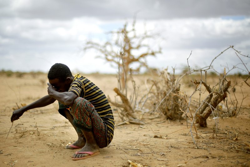 Muhumed Surow grieves after the burial of his 1-year-old daughter Saturday at Ifo camp outside Dadaab, eastern Kenya, 60 miles from the Somali border. The girl died of malnutrition 25 days after reaching the camp.