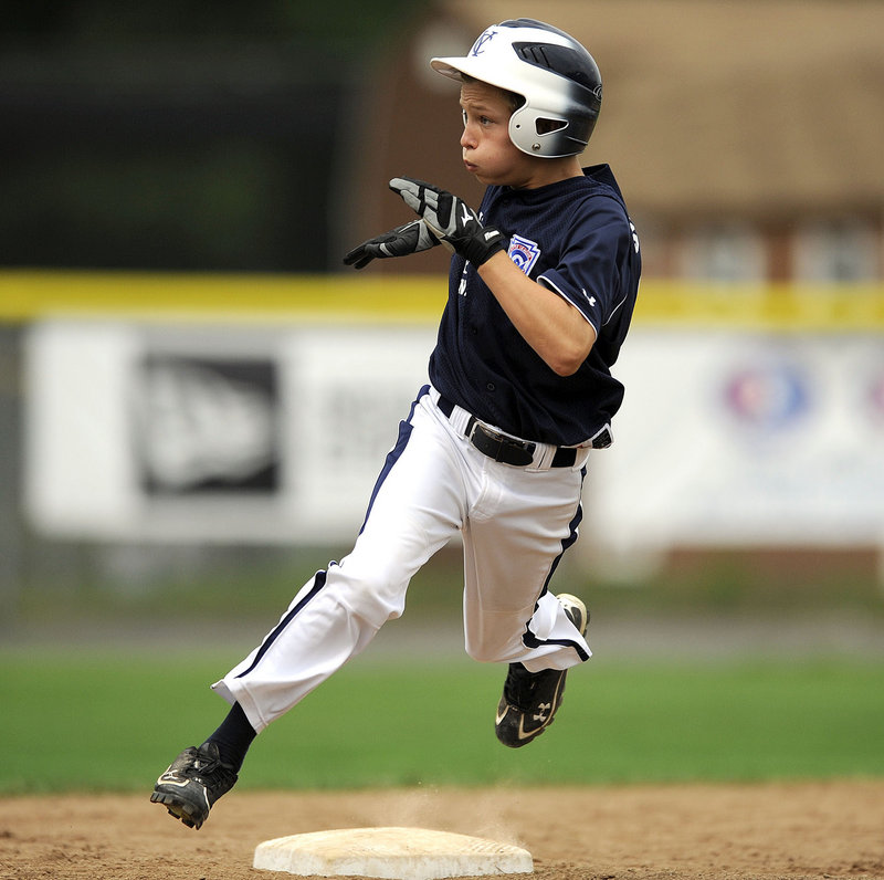 Jack Snyder of Maine champion Yarmouth rounds second and heads to third trying to stretch a double into a triple, but he was thrown out. Yarmouth lost 5-3 against Massachusetts Tuesday in the New England regional.