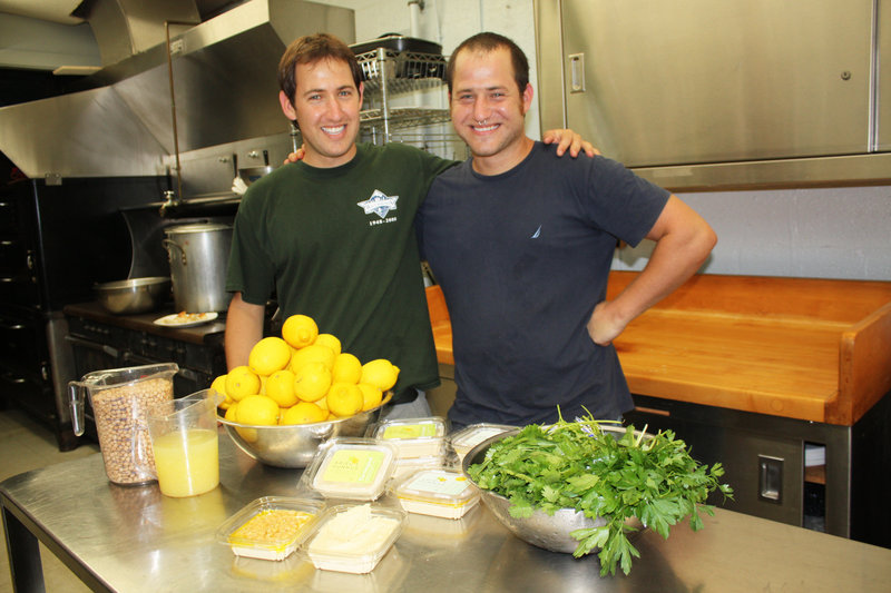 Brothers Ariel and Amit Glazer in the Portland kitchen where they make Ariel's Hummus.