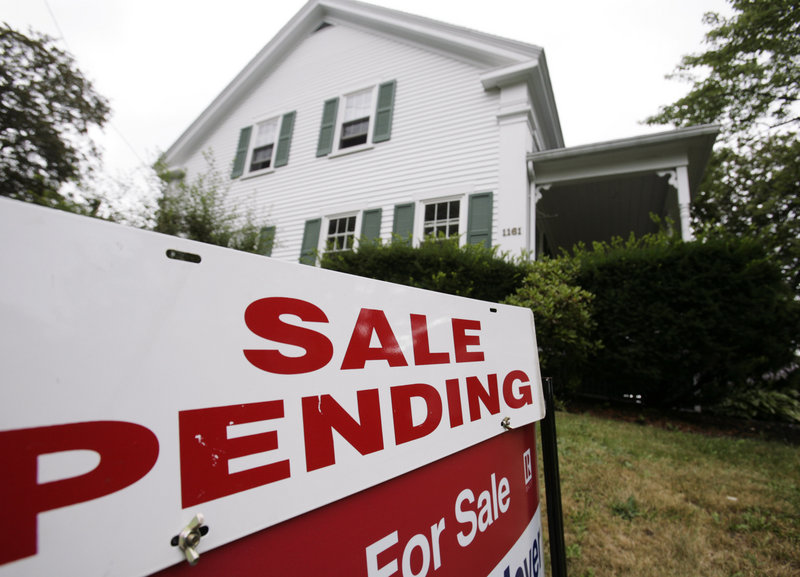 """An increasingly rare """"sale-pending"""" sign is posted at a house in Bath last month. Declining mortgage rates have yet to jump-start the nation's stagnant housing market."""