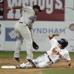Ryan Khoury of the Portland Sea Dogs slides under the tag of Akron second baseman Karexon Sanchez to collect a stolen base in the third inning Wednesday night.