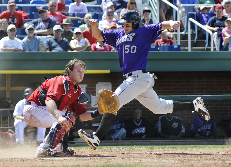 Raul Padron of the Akron Aeros strides to the plate Thursday as catcher Matt Spring of the Portland Sea Dogs awaits the throw during Akron's 13-5 victory at Hadlock Field.