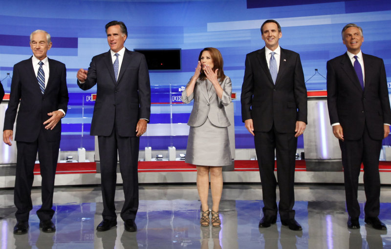 Republican presidential candidates, from left, Ron Paul; Mitt Romney, former Massachusetts governor; Michele Bachmann, U.S. representative from Minnesota; Tim Pawlenty, former Minnesota governor; and Jon Huntsman appear before the start of the GOP/Fox News Debate in Ames, Iowa, Thursday.