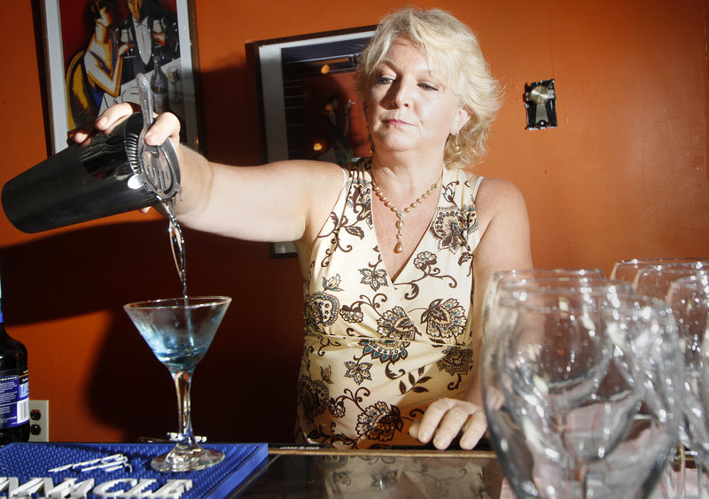 Deb Haggerty pours a blueberry martini at Jonathan's. The restaurant-bar's signature drink is the elderberry martini.