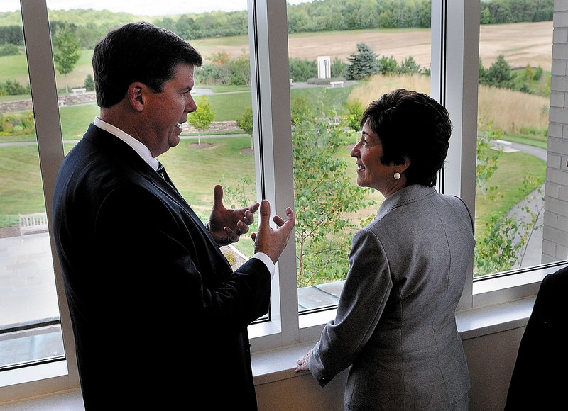 MaineGeneral Medical Center CEO Chuck Hays talks with Sen. Susan Collins, R-Maine, on Friday in Augusta.