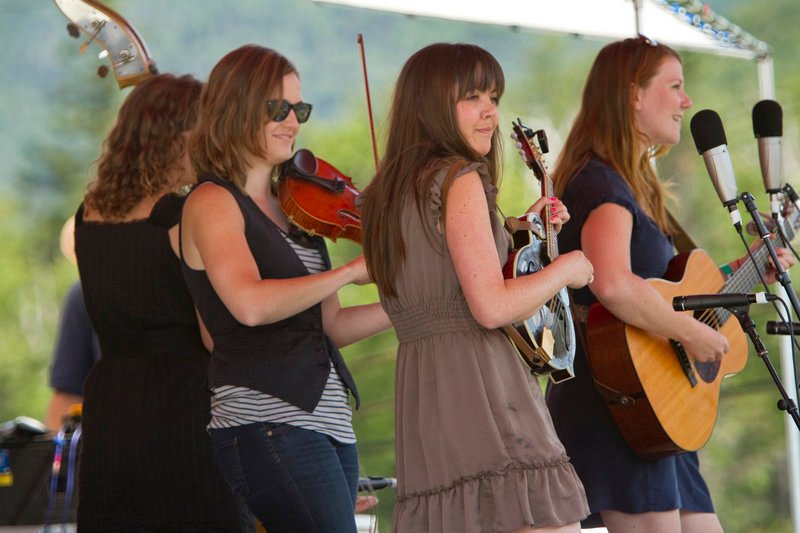 The band Della Mae plays for the crowd. They are, from left, Amanda Kowalski on bass, Kimber Ludiker on fiddle, Jenni Lyn Gardner on mandolin and Celia Woodsmith on guitar.