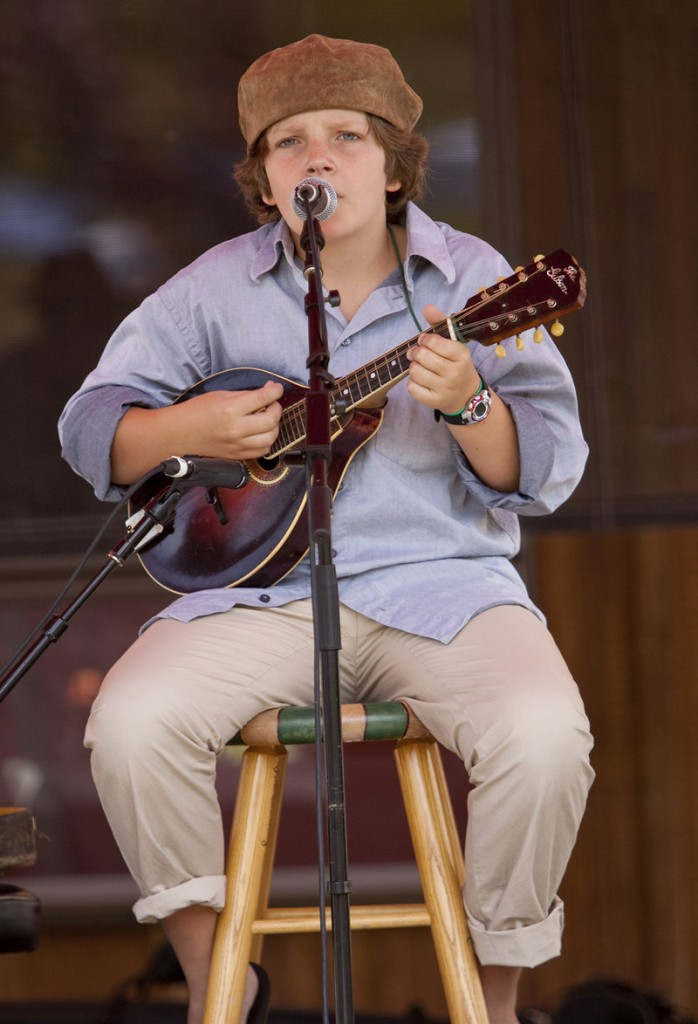 Mason Strunk, 12, grandson of the late singer-songwriter Jud Strunk, performs on Saturday.