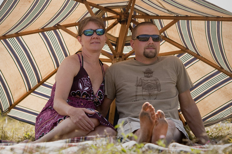 Kristen and Troy Haskell have it made in the shade of their umbrella on Saturday.
