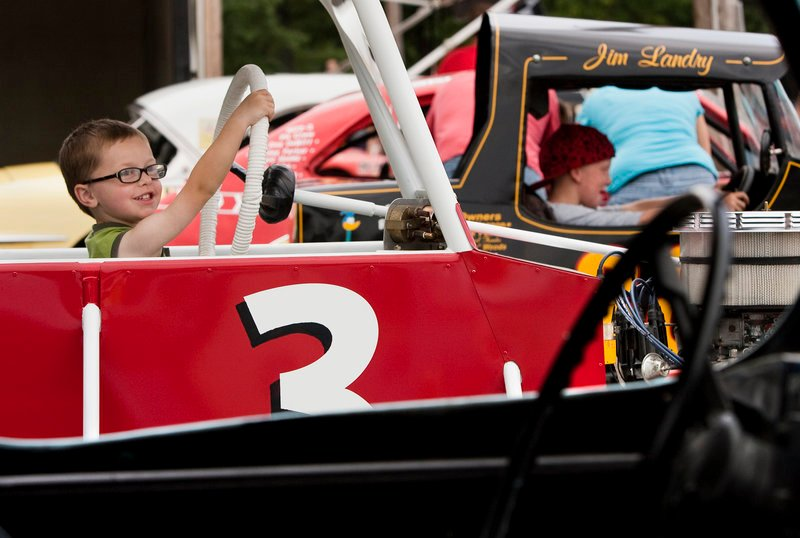 Sam Rondeau, 3, of Saco pretends to drive his grandfather's car during the Maine Vintage Race Car Association gathering at Beech Ridge Motor Speedway in Scarborough on Sunday.
