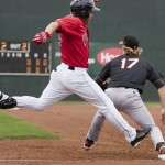 Ronald Bermudez of the Sea Dogs lunges for the bag and beats the throw to first base as he reaches on an error Sunday against the Erie SeaWolves. The Sea Dogs scored eight of their nine runs with two outs in a 9-5 victory.