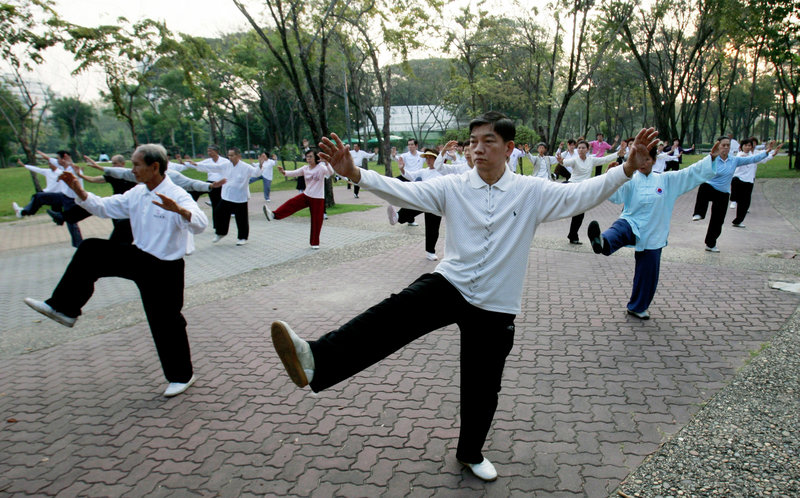 Men and women practice martial arts in Bangkok, Thailand. Regular exercise builds muscles, reduces the risk of some diseases and promotes mental well-being.
