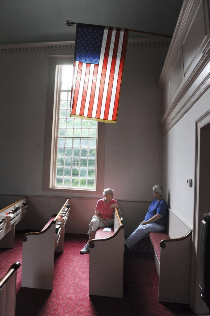 Barbara Littlefield of Kittery, left, and Linda Walton of York await the start of the 8 a.m. Sunday service inside the First Congregational Church of Kittery Point. The church was built in 1730 and is known as the oldest house of worship in Maine.