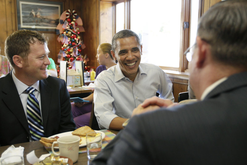 """President Obama talks with small-business owners Tuesday morning at Rausch's Cafe in Guttenberg, Iowa. """"You're what gives me strength,"""" he said later, praising rural residents."""