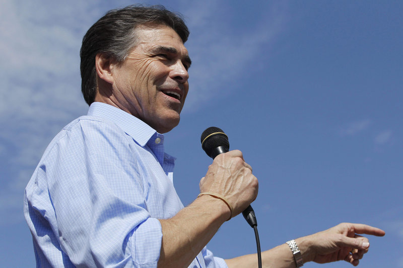 Texas Gov. Rick Perry speaks at the Iowa State Fair on Monday. To the national electorate, his style may be too much like another blunt Texan: former President George W. Bush.