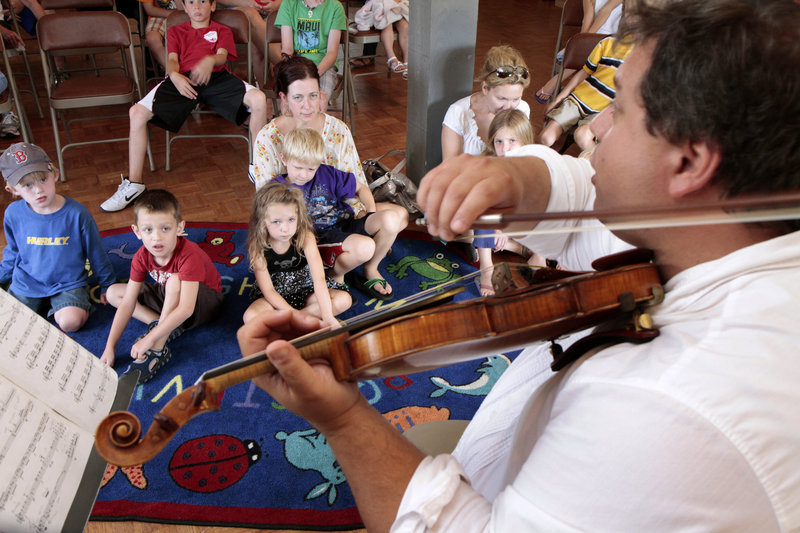 Ferdinand Liva of the DaPonte String Quartet performs in a recent concert for children at Rivertree Arts in Kennebunk. Liva and Myles Jordan are the two remaining original members of the quartet, founded 20 years ago.