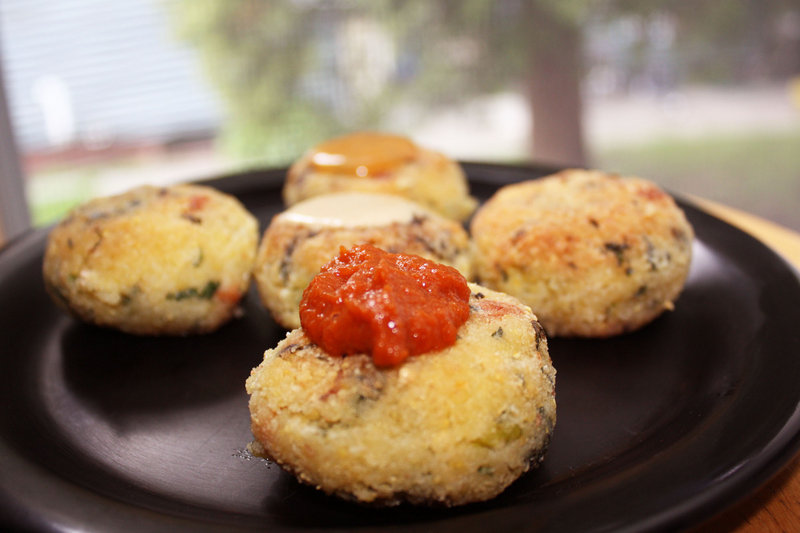 """Millet croquettes with three different sauces. The macrobiotic recipe was recently tested at the school for inclusion in Jessica Porter's forthcoming cookbook, """"The MILF Diet."""""""