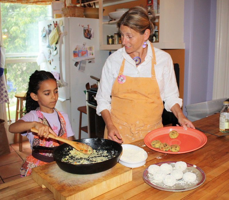 With help from her young friend Hana LaPaz Wallen, Lisa Silverman makes macrobiotic millet croquettes in the kitchen of the Five Seasons Cooking School.