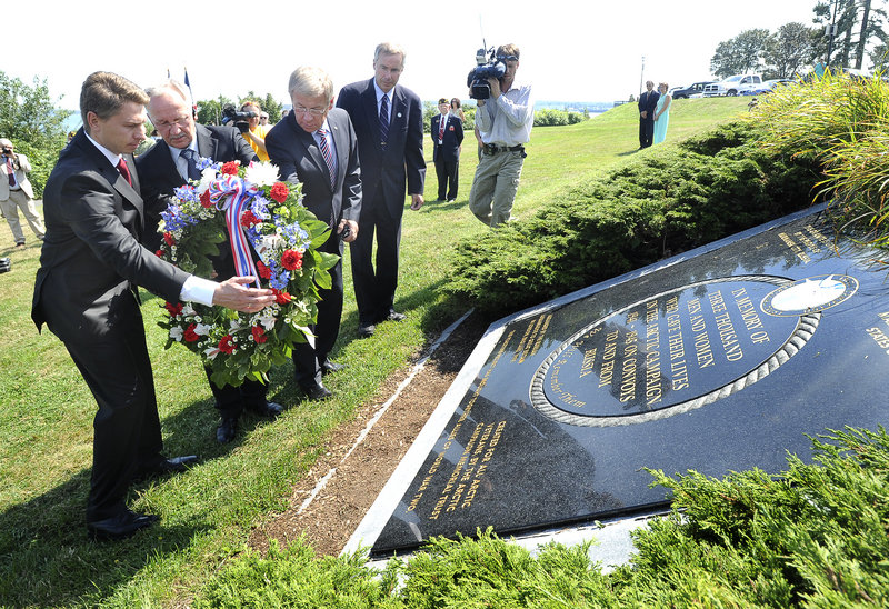 Russian delegates Andrey Bralnin, Sergey Emmanuilov and Stanislav Vtory lay a wreath on a plaque at the Eastern Prom to mark the 70th anniversary of Arctic convoys. During World War II, ships left Portland Harbor and braved many dangers to take supplies to Russia.