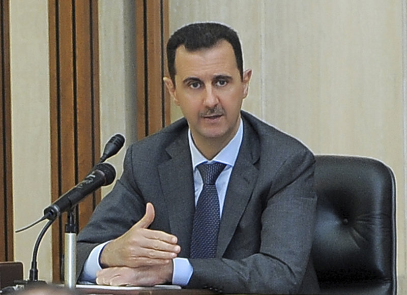 Syrian President Bashar Assad addresses a meeting for the central committee of the Baath party in Damascus on Wednesday. The resignation calls Thursday were the first explicit demands made by the U.S. and its European allies.