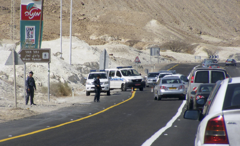 Vehicles straddle a security roadblock after a shooting attack along the border between Israel and Egypt.
