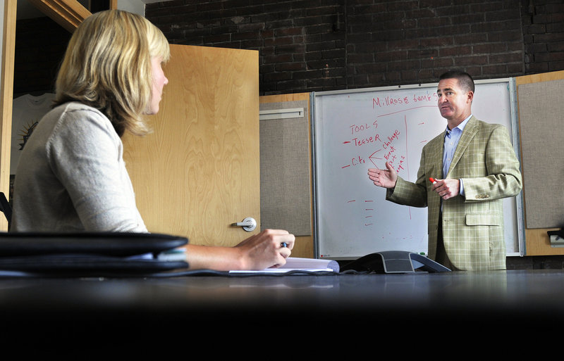 CEO Brian Corcoran meets with staff at Shamrock's offices on Commercial Street. His sports and entertainment marketing firm has eight employees now and he plans to add two to four staff members by early 2012.